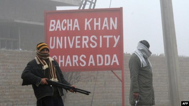 Pakistani security personnel stand near Bacha Khan University in Charsadda on January 25.