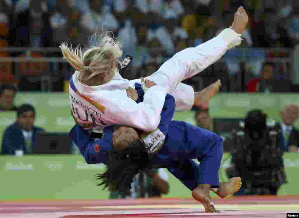 Judokas Eva Csernoviczki of Hungary (in white) and Otgontsetseg Galbadrakh of Kazakhstan compete in the women's 48-kilogram repechage contests. Galbadrakh ended up winning the bronze medal.
