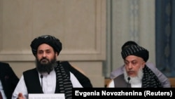 FILE: Taliban chief negotiators Mohammad Abbas Stanikzai (R) and Mullah Abdul Ghani Baradar during talks with senior Afghan politicians in Moscow in May.
