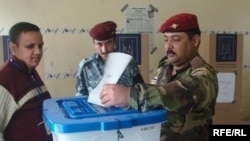 Iraqi soldiers vote early in Amara on March 4.