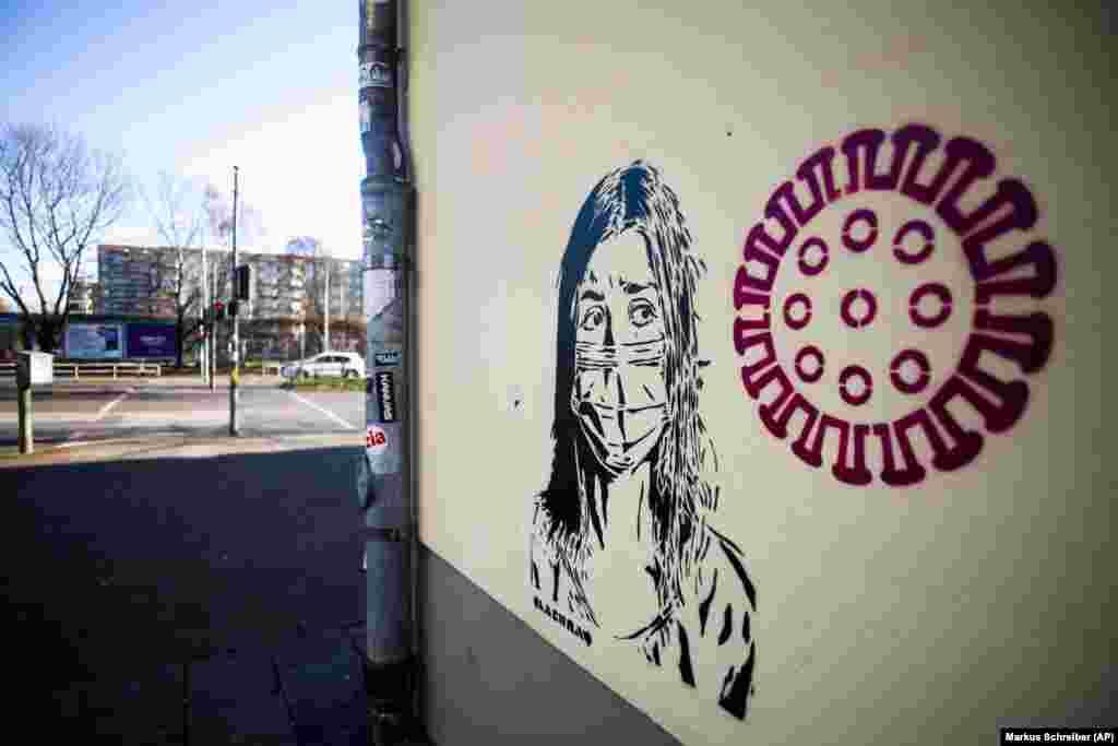 Графит в берлинския квартал Пренцлауер Берг, на който е изобразен страхът на едно момиче от коронавируса.
