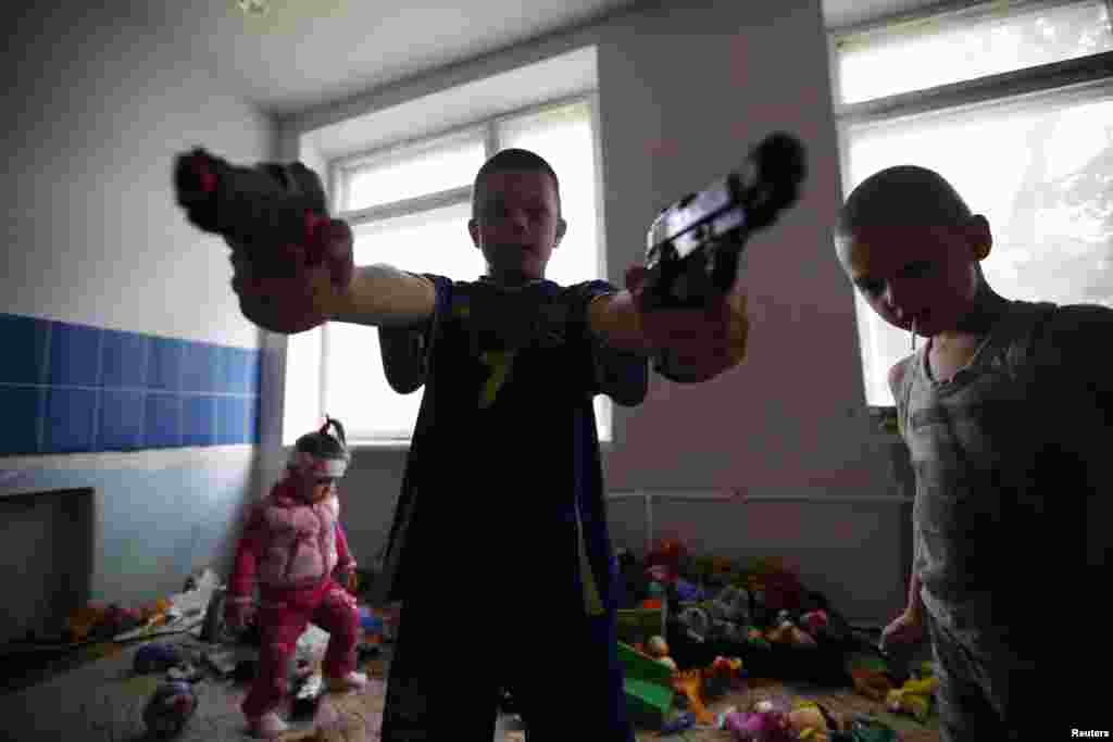 Children of families who have fled from fighting in Slovyansk play with toys at temporary accommodation in a dormitory in the eastern town of Ilovaysk on June 3.