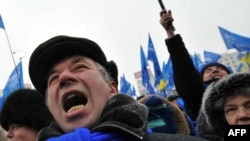 Yanukovych supporters celebrate at a rally in front of the Central Election Commision in Kyiv today.