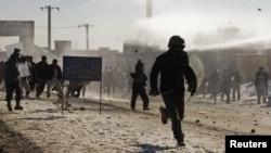 Afghan Koran-Burning Protests Turn Violent