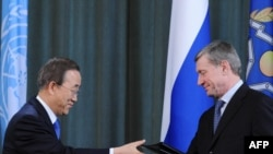 UN Secretary General Ban Ki Moon (left) exchanges signed documents with head of the Collective Security Treaty Organization Nikolai Bordyuzha at a press conference in Moscow on March 18, 2010