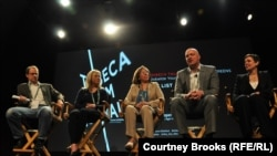 "A panel discussion about ""The List"" at the Tribeca Film Festival (left to right): George Packer, staff writer for ""The New Yorker""; director Beth Murphy; Anna Khanaka, one of the Iraqis that Kirk Johnson coordinated asylum for; Paul Rieckhoff, founder of Iraq and Afghanistan Veterans of America; lawyer Marcia Tavares Maack"