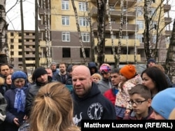 Monson addresses students at a school in Moscow.