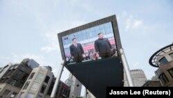 Predsednik Kine Si Đingping i severnokorejski lider Kim Džong Un tokom susreta u Pjongjangu