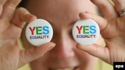 Angela McGlanaghey displays badges in favor of same-sex marriage in Donegal, Ireland.