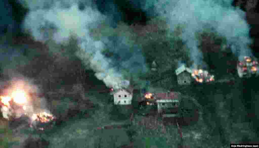 Houses burning on the outskirts of Mrkonjic Grad on January 15, 1996. The town was held by Bosnian Croat troops who had seized the area from rebel Serb troops.