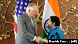 Indian Foreign Minister Sushma Swaraj greets U.S. Secretary of State Rex Tillerson in New Delhi on October 25.
