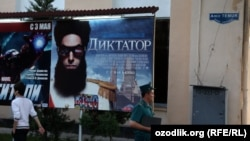 "A poster for the film ""The Dictator"" on a street in the Uzbek capital, Tashkent"