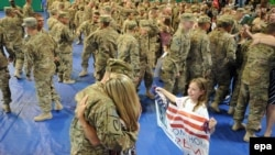 Soldiers are welcomed home after arriving from Afghanistan at Fort Stewart, Georgia.
