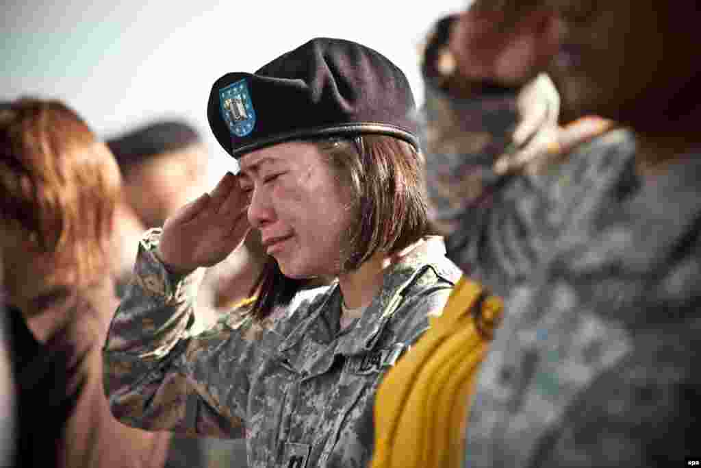 A U.S. soldier cries at a memorial service for the victims of a mass shooting at Fort Hood, Texas. On November 5, 2009, Nidal Hasan, a U.S. army major and psychiatrist, shot dead 13 people and injured 32 others at the military base. He was captured, tried by a military court, and sentenced to death by lethal injection. The case is currently under review by appellate courts.