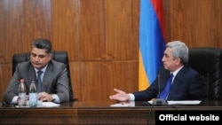 Armenia -- President Serzh Sarkisian (R) addresses Prime MInister Tigran Sarkisian during a government meeting in Yerevan, 15Sep2012.