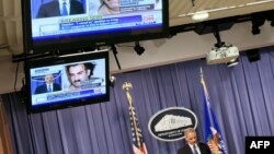 U.S. Attorney General Eric Holder speaks during a news conference in April 2011 announcing that accused 9/11 mastermind Khalid Sheikh Mohammad will be tried before a military commission.