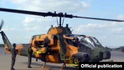 Azerbaijan - A Turkish AH-1W Super Cobra helicopter parked at an Azerbaijani military airfield, 20Sep2014.