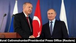 Реджеп Эрдоган (слева) и Владимир Путин (справа)