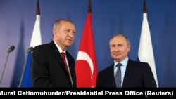 Реджеп Эрдоган (слева) и Владимир Путин (справа).