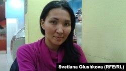 Сандугаш Серикбаева, около недели протестовавшая на кране, чтобы отстоять свой дом. 28 ноября 2013 года.