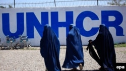 Afghan burqa-clad women arrive to get registered during United Nation High Commissioner for Refugees (UNHCR) voluntary return program in Chamkani, on the outskirts of Peshawar on April 3.