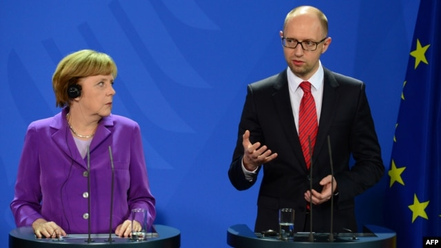 German Chancellor Angela Merkel (left) listens to Ukraine's Prime Minister Arseniy Yatsenyuk during a joint press conference after talks in Berlin on May 28.