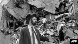 A man walks over the rubble left after a bomb exploded at the Argentinian Israelite Mutual Association in Buenos Aires in July 1994, killing 85 people and injuring about 300 others in the worst attack of its kind in the South American country.