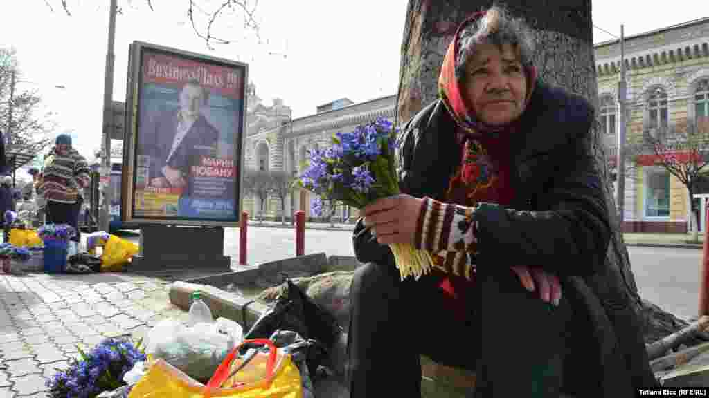 A woman sells flowers in Chisinau.