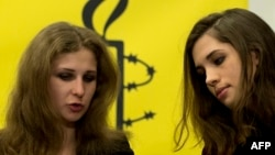 Maria Alyokhina (left) and Nadezhda Tolokonnikova of Pussy Riot appear at a news conference in New York on February 4.
