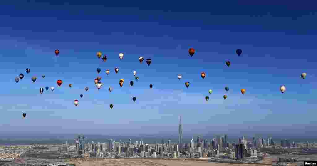 Hot air balloons fly over Dubai during the World Air Games 2015. (Reuters/Karim Sahib)