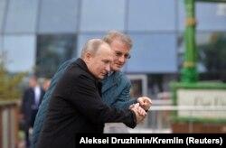Герман Греф и Владимир Путин