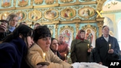 Relatives and friends mourn one of the miners killed in the tragedy at the Raspadskaya mine.