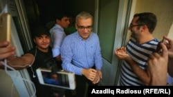Azerbaijani opposition leader Ilqar Mammadov is greeted by supporters upon his release on August 13.