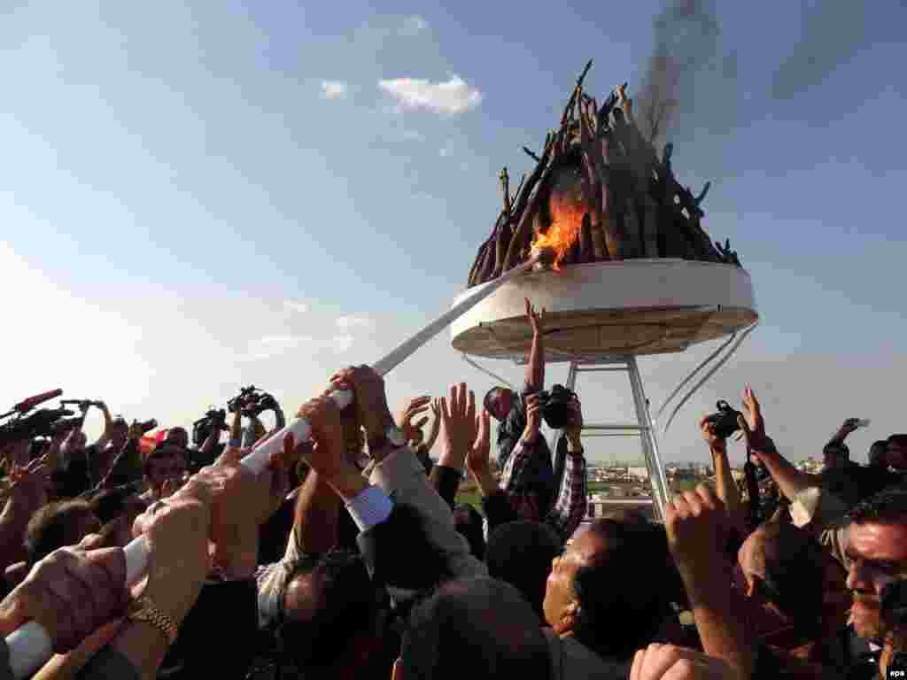 Iraqi Kurdish men gather around a bonfire as they celebrate Norouz in the northern Iraqi city of Kirkuk.