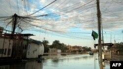 مياه الأمطار تغطي شارعاً في أحد أحياء بغداد