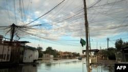 احدى شوارع بغداد في 26كانون2012 بعد الامطار الغزيرة