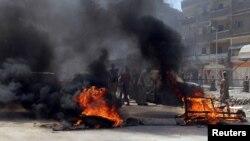 """Во время протестной акции в Каире в августе, организованной сторонниками движения """"Братья-мусульмане"""". Подобные выступления нередко сопровождаются столкновениями с полицией"""
