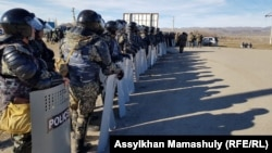 Riot police deployed to the village of Masanchi on February 8.