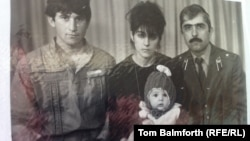 A family photo: Anzor Tsarnaev (left), Zubeidat Tsarnaeva, and Anzor's brother Mukhammad Tsarnaev in an undated photo. They are holding young Tamerlan Tsarnaev.