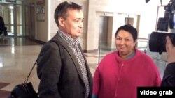 Кандидаты в Госдуму Ирек Муртазин и Рушания Бильгильдеева после судебного заседания 1 сентября 2016 года