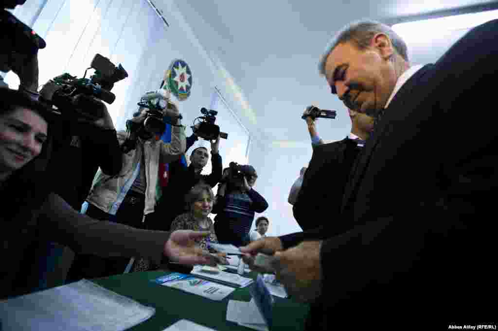 Presidential candidate Camil Hasanli casts his ballot at a polling station in Baku.