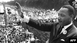 Civil rights leader Martin Luther King Jr. waves to supporters from the Lincoln Memorial on the Mall in Washington during the March on Washington on August 28, 1963.