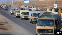 "battleground Syrian town of Kobane. ""Forty vehicles carrying machineguns and weapons and artillery with 80 of t"