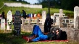 Bosnia-Herzegovina - Migrants sleep at a cemetery after migrant camp burned in Velika Kladusa, 1Jun2019
