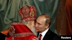 Президент Владимир Путин и глава Русской православной церкви, патриарх Кирилл