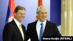 German Foreign Minister Guido Westerwelle (left) is welcomes by Serbian President Boris Tadic in Belgrade.