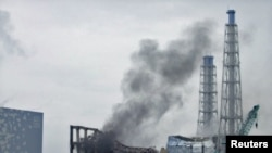 Gray smoke rises from the area of the No. 3 reactor of the Fukushima nuclear power plant today.