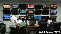 FILE: Reporters at work in the Tolo TV station in Kabul.