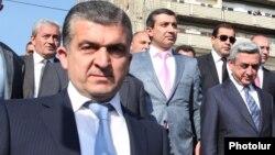 Armenia - President Serzh Sarkisian (R) and his chief bodyguard Vachagan Ghazarian (L), Yerevan, April 14, 2012.
