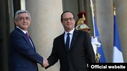France -- France's President Francois Hollande greets his Armenian counterpart Serzh Sarkisian in Paris, 27Oct, 2014